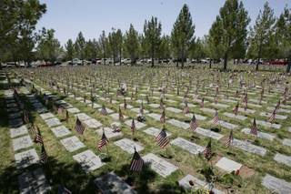 American Flags mark grave stones at a Memorial Day program held in remembrance of those who served in the U.S. military at the Southern Nevada Veterans Memorial Cemetery in Boulder City Monday, May 25.