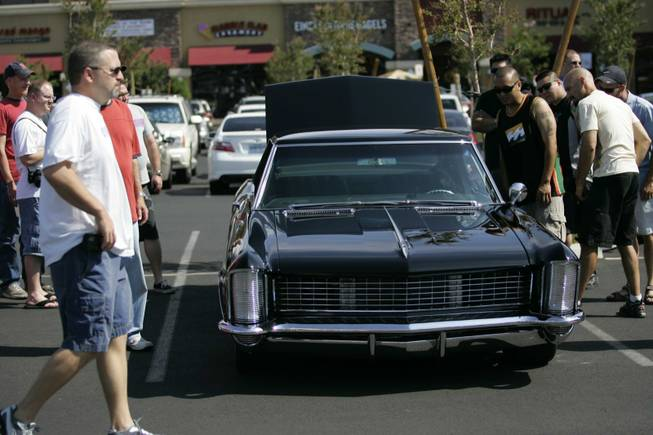 People view exotic and classic cars at Sansone Park Place.
