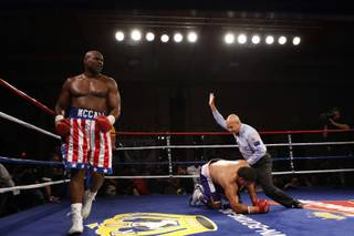 Oliver McCall walks around the ring as referee Joe Cortez calls off the fight with John Hopoate of Australia during a heavyweight bout at The Orleans Friday May 22, 2009. McCall beat Hopoate, a former rugby player, with a second-round knock out.