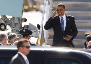 President Barack Obama salutes as he arrives at McCarran International Airport Tuesday.
