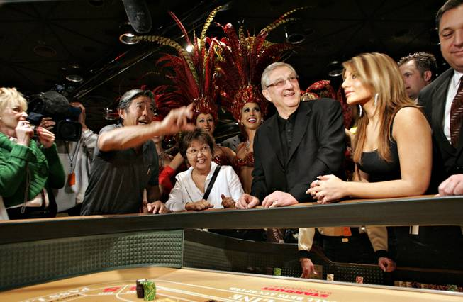 Jimmy Kumihiro of Hawaii throws the final craps game with Bill Boyd on hand, center, during the closing of the Stardust Resort and Casino on Wednesday morning.