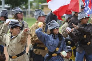 Confederate soldiers Liliana Amezcua, left, and Lizbeth Santiago-Cruz take aim at Union troops while fighting in the Battle of Bull Run during the fifth-grade annual Civil War Reenactment Friday at Edna Hinman Elementary School.