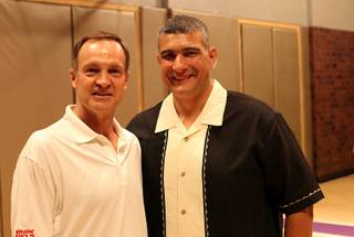 UNLV head coach Lon Kruger poses with Kansas State head coach Frank Martin on Sunday night at the Hardwood Suite at the Palms in Las Vegas.