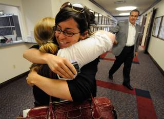 Rebecca Gasca, public advocate for ACLU of Nevada, hugs Lee Rowland, northern coordinator for the ACLU of Nevada, shortly after the Nevada Assembly overrode the governor's veto of Senate Bill 283 at the Nevada Legislature on Sunday in Carson City.  Also pictured is Greg Ferraro with the Nevada Resort Association.