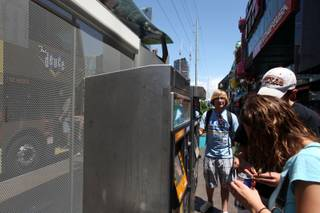 Durango High School senior Colby Laub, 17, answers questions for tourists as a Deuce ambassador at a Las Vegas Strip bus stop on Sunday, May 31, 2009.