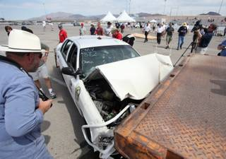A controlled high-impact collision of a car into a tractor-trailer is shown Monday during the annual Crash Conference hosted by the North Las Vegas Police Department Traffic Division at the Las Vegas Motor Speedway.
