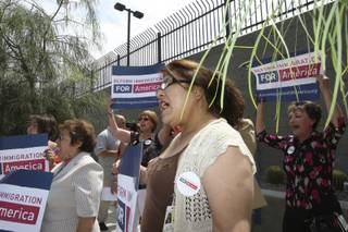 Rosa Acevedo, center, cheers with other supporters during a press conference launching the national Reform Immigration for America campaign Monday outside the Lloyd George Federal Building in Las Vegas.