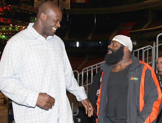 In this image released by CBS, NBA star Shaquille O'Neal, left, poses with mixed martial arts heavyweight sensation Kimbo Slice at the official CBS EliteXC Saturday Night Fights weigh-in at the Prudential Center in Newark, N.J. on May 30, 2008.