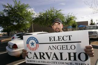 North Las Vegas Ward 3 candidate Angelo Carvalho pauses for a photo as he greets voters Tuesday outside the Silver Mesa Community Center.