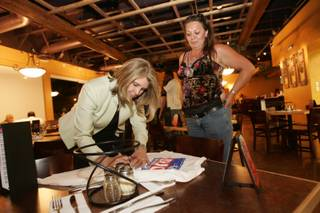 Shari Buck signs a T-shirt for campaign supporter Toni Lopez-Gonzales after Buck won Tuesday's election to become the next mayor of North Las Vegas. Buck defeated fellow City Council member William Robinson by a vote of 5,364 to 4,427.