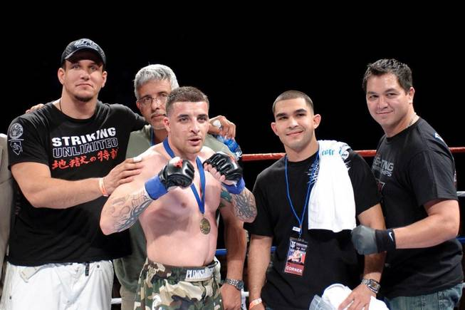Larry Mir, center, the cousin of UFC interim heavyweight champ Frank Mir, scored a successful MMA debut Saturday night at the Orleans arena when he defeated Samual  Varrin by split decision.