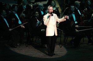 Music Director David Itkin addresses the audience before the Las Vegas Philharmonic's pops concert in March. Itkin has appealed for help from audiences during performances, and even made calls to subscribers asking them to renew.