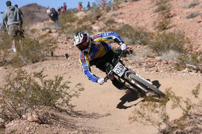 A bicyclist hits the trails at Bootleg Canyon in Boulder City during a competition.