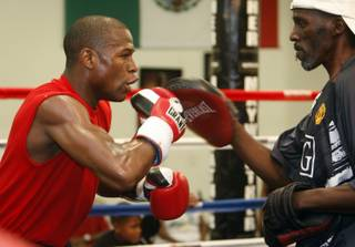 Boxer Floyd Mayweather Jr., left, works on his timing with his uncle Roger Mayweather during a workout in his gym Thursday, June 11, 2009.