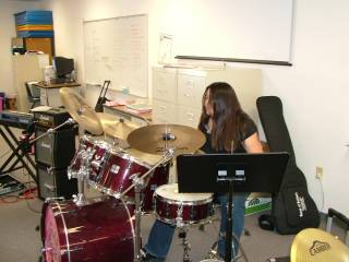 Camp director Heather Rampton provides some percussion tips at Girls Rock Vegas,  a Las Vegas summer camp that provides young girls with rock music instruction, promotes self expression and provides support.