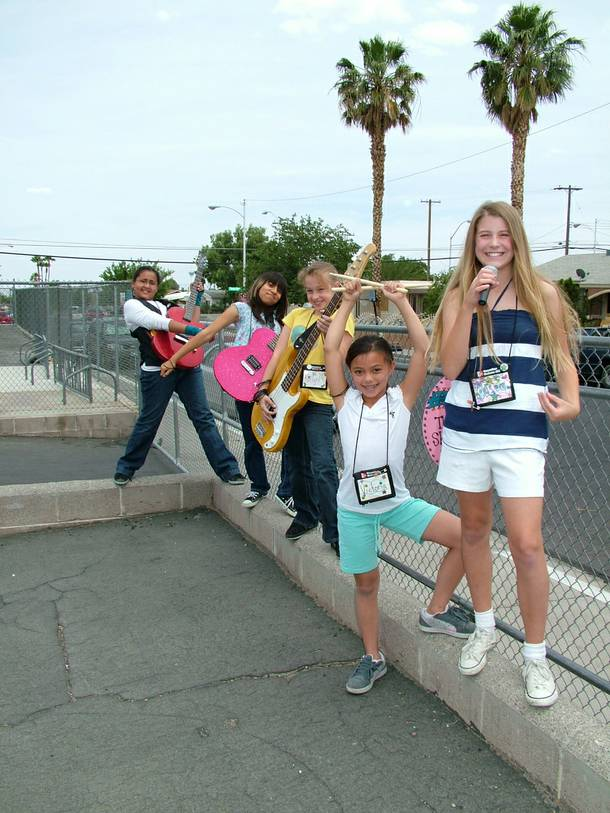 The Shooting Starz, an all-girl band at Girls Rock Vegas, are from left: MykKayla Hall, Rosa Ruiz, Kaitlyn May, Victoria Santos and Casey Van Hoos.  The Las Vegas summer camp provides young girls with rock music instruction, promotes self expression and provides support.