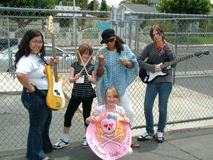 """The Flaming Skulls of Death,"" an all-girl band at Girls Rock Vegas, are Candace Chun (an instructor at the camp), Jessie Lea, Ashley Lybarger, Tahirra Jackson and Nona Fuller. The  Las Vegas summer camp provides young girls with rock music instruction, promotes self expression and provides support."