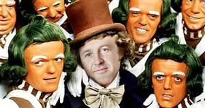 Trevor Groth (middle) with a collection of Oompa-Loompas.