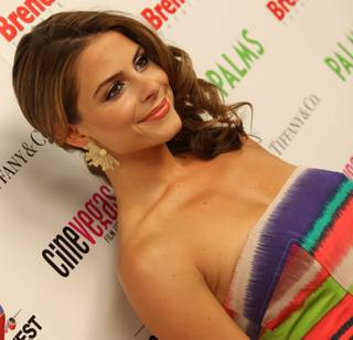 Maria Menounos poses for pictures Sunday during the CineVegas 2009 Honorees reception red carpet at Rain nightclub at The Palms Hotel and Casino.