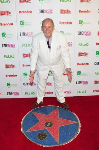 Robin Leach admires his star at the Brenden Celebrity Star Presentation during the CineVegas Film Festival.
