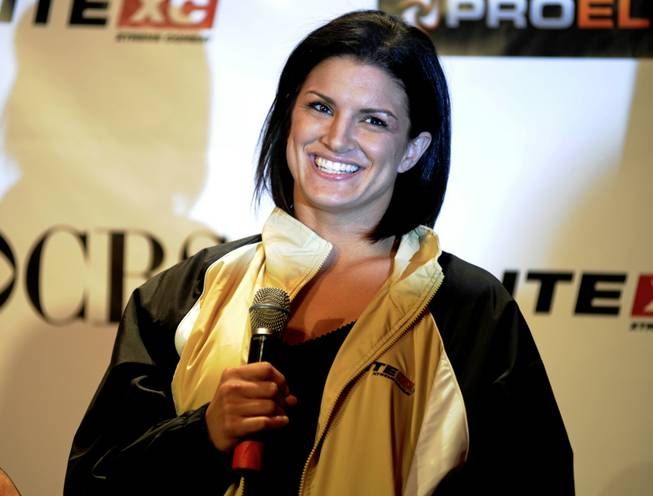 "Mixed Martial arts fighter and former UNLV student Gina Carano speaks during a news conference May 29, 2008, in New York. Carano is scheduled to fight Cris ""Cyborg"" Santos for the first-ever Strikeforce 145-pound women's world title in San Jose, Calif. on Aug 15."