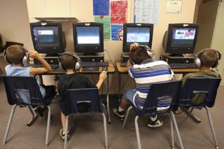 First- through third-grade students concentrate on educational computer games tailored for their individual reading and language skills during the summer Fast ForWord Program June 17 at Martha P. King Elementary School.