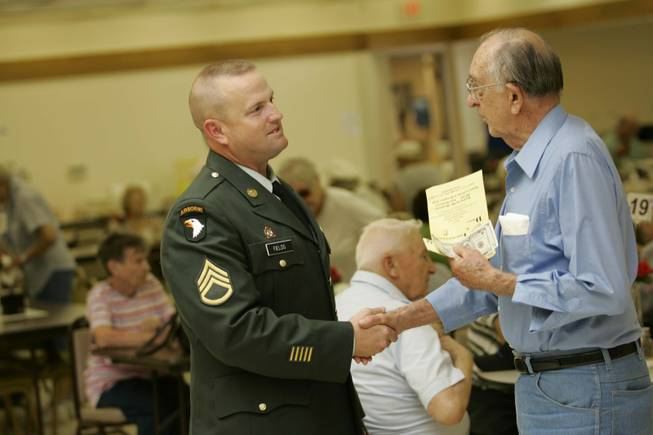 Army Staff Sgt. Jonathan Fields, left, talks with Frank Mathews at the Boulder City Senior Center on June 19.