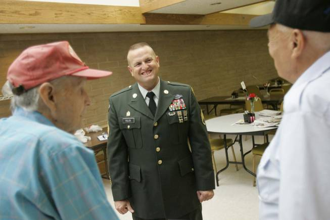 Army Staff Sgt. Jonathan Fields, center, chats with Danny Noonan, left, and Arthur Monetti at the Boulder City Senior Center on  June 19.