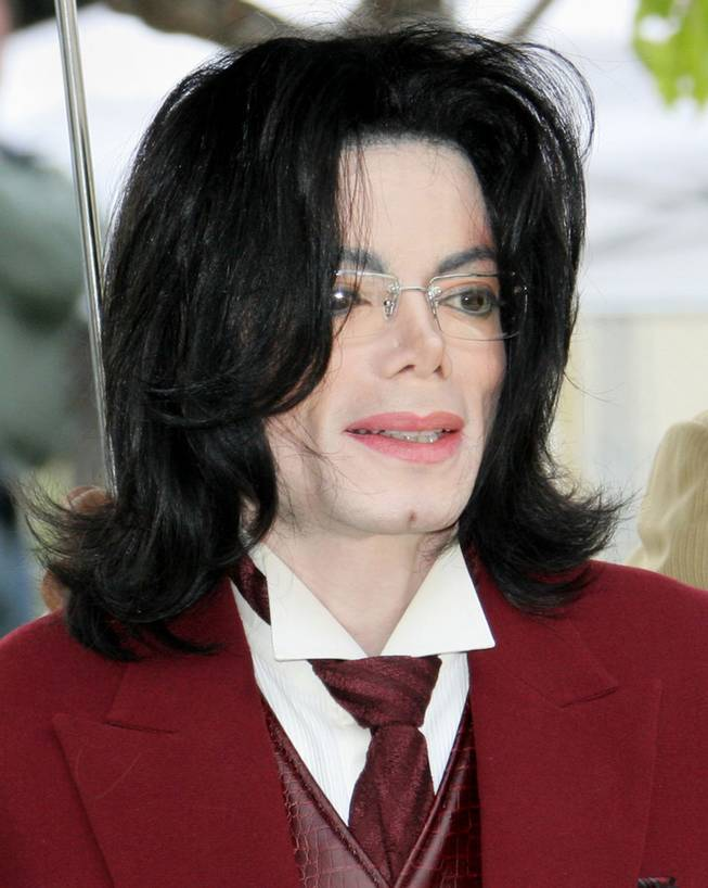 Michael Jackson arrives at the Santa Barbara County courthouse in this April 27, 2005, file photo in Santa Maria, Calif.