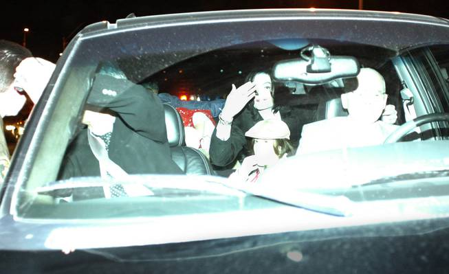 Michael Jackson blows kisses to fans from inside a vehicle just outside of Green Valley Ranch on Nov. 20, 2003. Jackson left Las Vegas on that morning and flew to Santa Barbara, Calif., to turn himself in to authorities on charges of child molestation. He landed at the Henderson Executive Airport that afternoon and drove around Las Vegas and Henderson in a black sport utility vehicle for more than two hours.