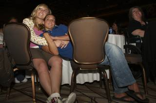 Six-year partners Karlie Gabour, 23, and Savannah Miele, 22, cuddle in each others' arms while listening to speakers during a domestic partnership celebration Thursday at the Rio. Gabour and Miele look forward to their opportunity to register as domestic partners Oct. 1.