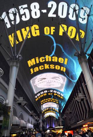 A video tribute to fallen pop icon Michael Jackson plays across the canopy of the Fremont Street Experience on Thursday night.