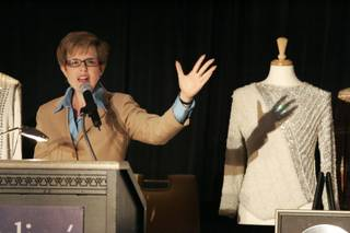 Kathleen Guzman calls for bids next to a shirt worn by Michael Jackson on his