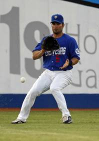 Las Vegas 51s outfielder David Dellucci fields a ground ball during a game against the Sacramento River Cats at Cashman Field Monday, June 29, 2009. Dellucci, who recently signed a minor league contract with the Toronto Blue Jays, the 51s' parent club. Dellucci was part of the Arizona Diamondbacks World Series champion team in 2001 and a proven big league player.