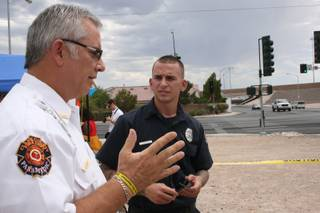 Clark County Fire Department public information officer Scott Allison discusses fireworks safety with fire inspector Dan Bushkin Tuesday.