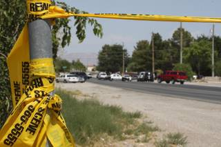 Crime scene tape blocks residents from entering their neighborhood while Metro Police investigate after an officer-involved shooting July 1 in the 5500 block of Alexander Drive, near Helen Street and Rancho Drive.