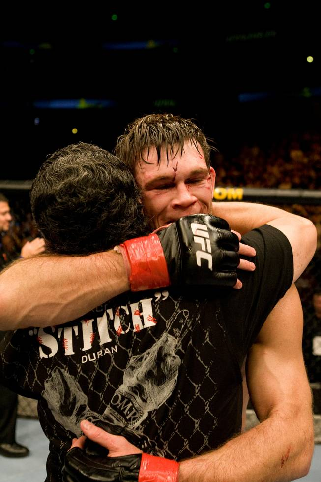 "Former UFC light heavyweight champ Forrest Griffin hugs cutman Jacob ""Stitch"" Duran. Duran says the best part of his job is developing special bonds with fighters after performing one of his successful 60-second surgeries between rounds."