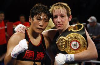 Fujin Raika, left, of Tokyo and WBA/GBU lightweight champion Layla McCarter of Las Vegas pose after a 10-round fight at the South Point Friday, July 3, 2009. McCarter defended her titles with a unanimous decision win.