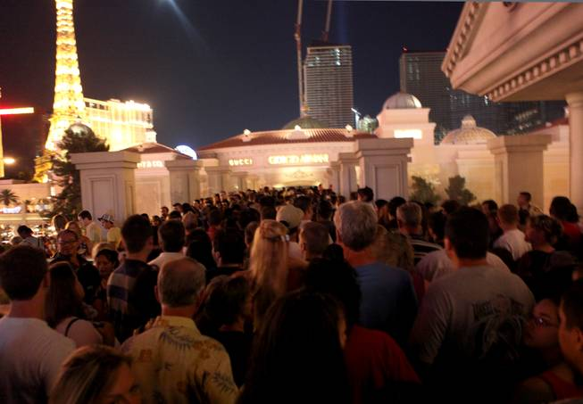 Fourth of July crowds pack the pedestrian bridge outside the Bellagio on the Las Vegas Strip in 2009.