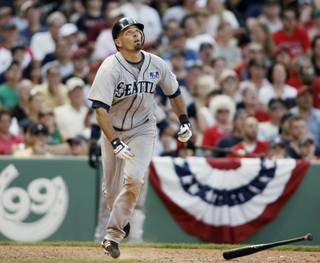 Seattle Mariners' Chris Woodward watches his game winning bloop RBI single during the ninth inning of their 3-2 win over the Boston Red Sox in a baseball game at Fenway Park in Boston Saturday, July 4, 2009.