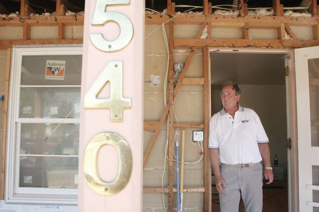 Homeowner Jack Gaal stands at the entrance to his home at 540 Birch St., in the historic home district of Boulder City. Seen here in 2008, Gaal spent two years renovating his residence.