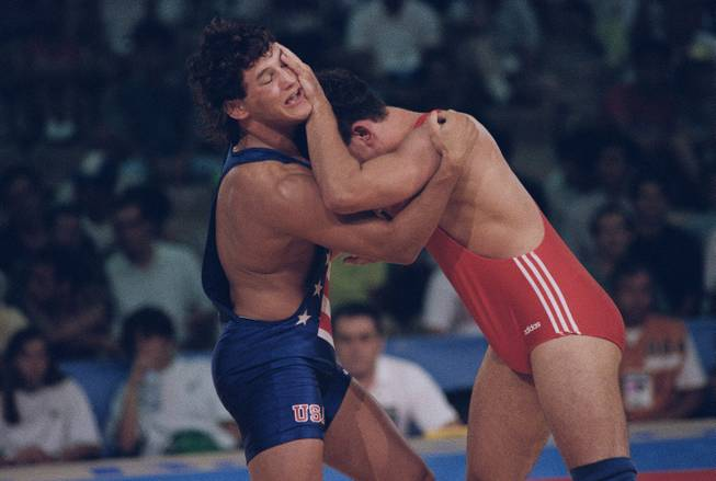 Wrestlers making choice between Olympics or MMA