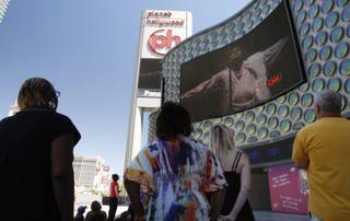 People watch live television news coverage of the Michael Jackson memorial outside Planet Hollywood on Tuesday.