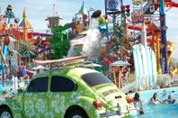 A Volkswagen Beetle squirts water out in the foreground of the overview image of a Utah Cowabunga water park. (Courtesy Photos)
