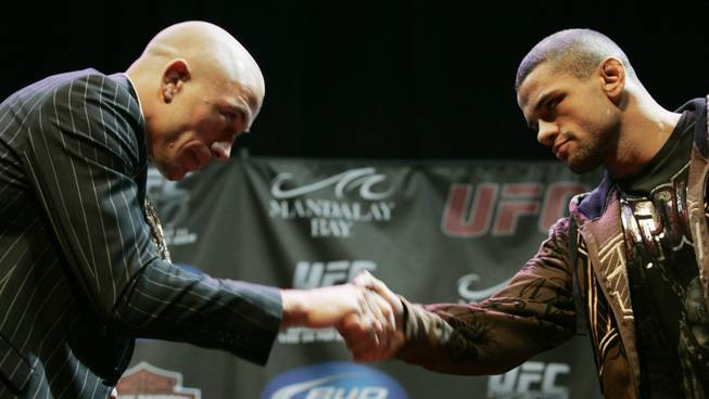 Georges St. Pierre, left, and Thiago Alves bow and shake hands after squaring off at a news conference for UFC 100 at Mandalay Bay Thursday, July 9, 2009. UFC 100 takes place Saturday, July 11th at the Mandalay Bay Events Center.