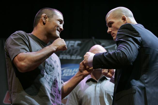 Dan Henderson, left, and Michael Bisping square off at a news conference for UFC 100 at Mandalay Bay Thursday, July 9, 2009. UFC 100 takes place Saturday, July 11th at the Mandalay Bay Events Center.