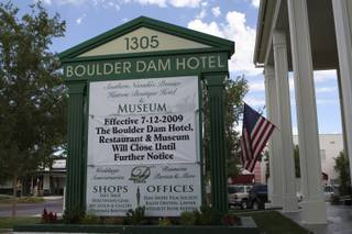 A closing banner hangs in front of the Boulder Dam Hotel.