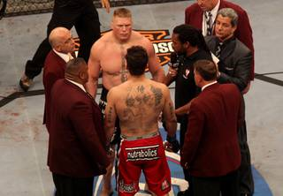 Brock Lesnar and Frank Mir meet just before their heavyweight title fight at UFC 100 at Mandalay Bay. Lesnar won with stoppage in the second round.