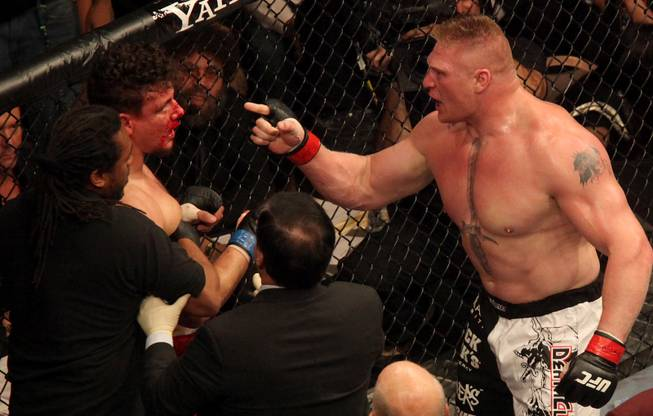 Brock Lesnar gets in Frank Mir's face after defeating Mir in their heavyweight title fight at UFC 100 at Mandalay Bay on July 11, 2009. Lesnar won with stoppage in the second round.