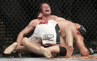 Mark Coleman gets Stephan Bonnar up against the fence during their fight at UFC 100. Coleman won by unanimous decision.